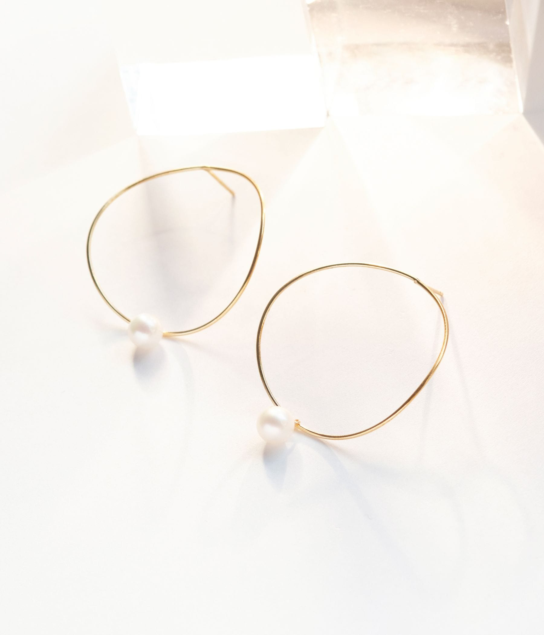 curvy circle pearlピアス